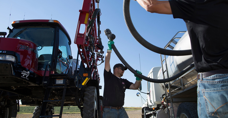 filling a tractor with diesel fuel