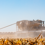 Farm equipment in field during harvest
